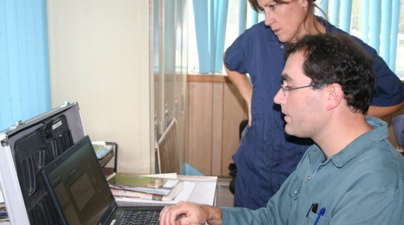 Dr. Jean-Philippe Roy and Anne-Marie Christen analyzing data on farm.